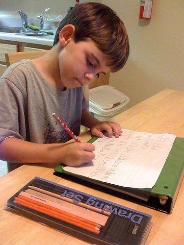 Pictures Of Boy Doing Homework At Kitchen Table