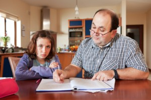 father doing homework for daughter