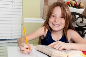 happy-girl-doing-homework
