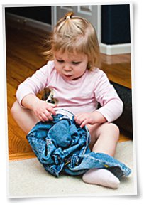 110327-little-girl-putting-pants-on