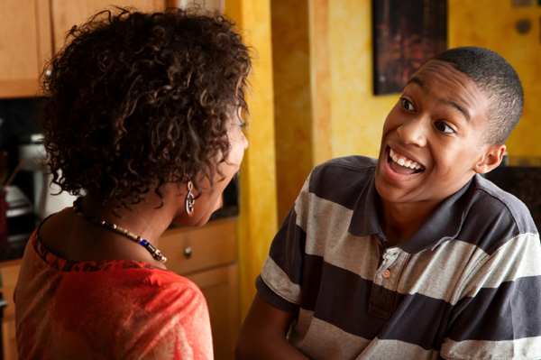 mother-and-teen-son-talking-in-kitchen (1)
