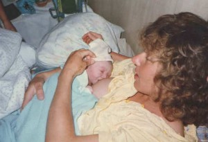 Me, nursing my fourth after her home birth.
