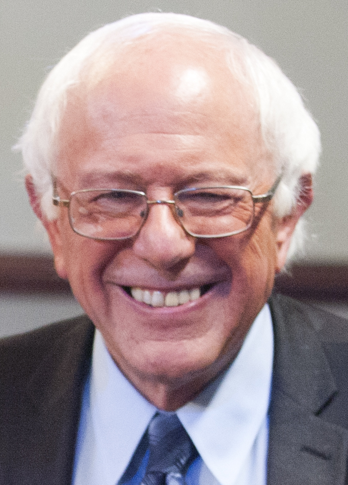 """Bernie Sanders September 2015 cropped"" by Miller Center - https://www.flickr.com/photos/miller_center/22198449539/in/photolist-zPAREB-A3pezm-A4xwyA-zEJfdx-zAdZB9-zNY5jG-zQMLua-zMyPCo-ySZG14-zMyt6b-zPSbvZ-zMyanf-zxgvis-zMxRJj-ySPLX9-zMxznb-zMxq4G-ySXNd8-zxdEsY-zxdsBo-zxhR98-zNF2Gw-ySL8dh-zxcebW-zxc5w1-zNQQXq-zxkU7h-zMDPjs-zMDH3Q-zMDx3Q-zxrtFF-yT5igM-zMDanf-zPWVPp-zNPJnJ-zQRusT-ySUDXs-zxqzfZ-yT4pM4-zNP2mW-ySU5td-zxpVji-zxkaD9-zQPKQF-zxowg6-zvFhWP-zKByhL-zmM7bS-yGkQFs-zmM64S. Licensed under CC BY 2.0 via Commons - https://commons.wikimedia.org/wiki/File:Bernie_Sanders_September_2015_cropped.jpg#/media/File:Bernie_Sanders_September_2015_cropped.jpg"